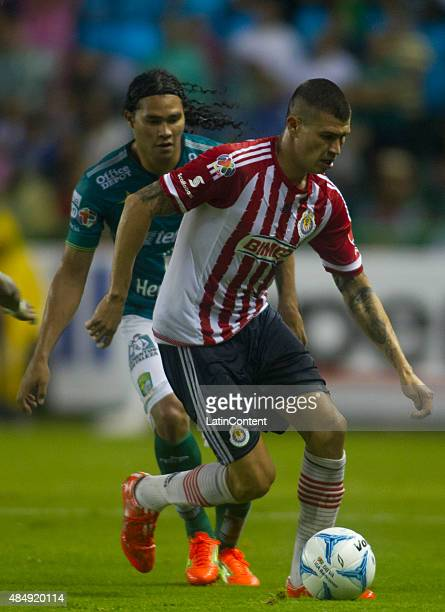 Jorge Enriquez of Chivas fights for the ball with Carlos Peña of León during during a 6th round match between Leon and Chivas as part of the Apertura...
