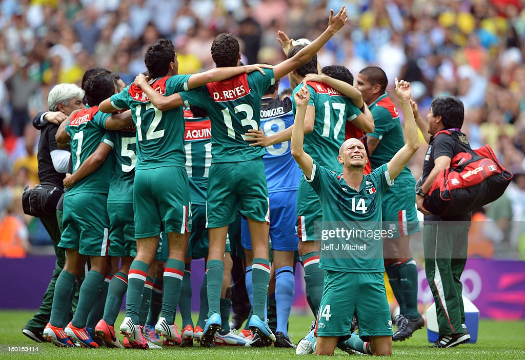 <a gi-track='captionPersonalityLinkClicked' href=/galleries/search?phrase=Jorge+Enriquez&family=editorial&specificpeople=6623957 ng-click='$event.stopPropagation()'>Jorge Enriquez</a> of Mexico falls to the ground with jubilation as team-mates celebrate winning the gold medal after the Men's Football Final between Brazil and Mexico on Day 15 of the London 2012 Olympic Games at Wembley Stadium on August 11, 2012 in London, England.