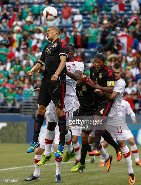 Jorge Enriquez of Mexico heads the ball against Canada at CenturyLink Field on July 11 2013 in Seattle Washington
