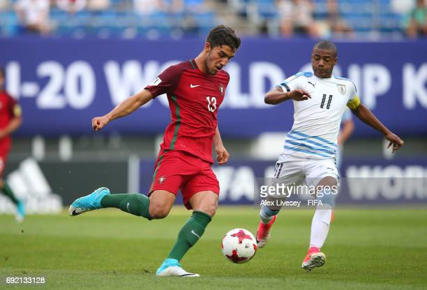 Jorge Fernandes of Portugal passes the ball ahead of Nicolas de la Cruz of Uruguay during the FIFA U20 World Cup Korea Republic 2017 Quarter Final...