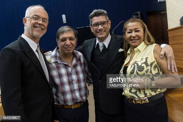 Jorge Ferreira poses with his parents and his partner Alex Magalaes before their wedding ceremony at the Court of Justice of the State of Rio de...