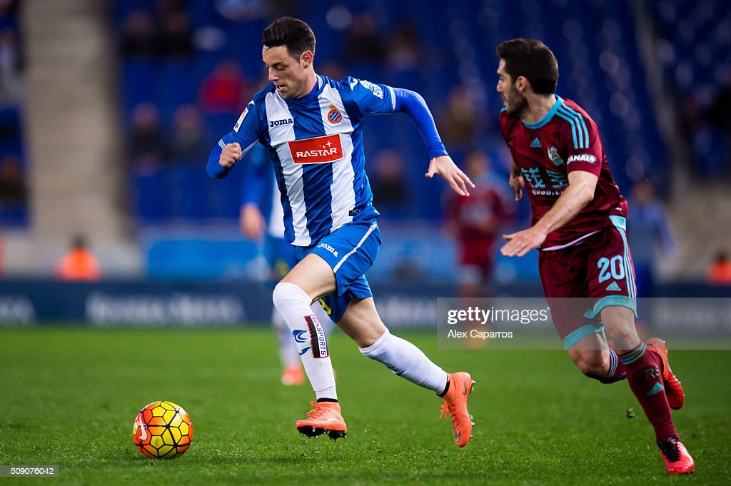 Jorge Franco 'Burgui' (L) os RCD Espanyol conducts the ball next to Joseba Zaldua of Real Sociedad de Futbol during the La Liga match between RCD Espanyol and Real Sociedad de Futbol at Cornella-El Prat Stadium on February 8, 2016 in Barcelona, Spain.