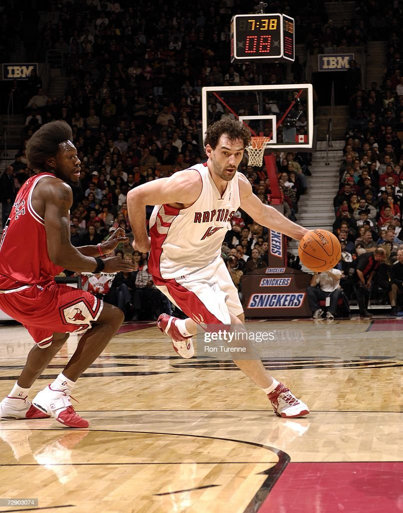 Jorge Garbajosa of the Toronto Raptors drives hard around Ben Wallace of the Chicago Bulls on December 29 2006 at the Air Canada Centre in Toronto...