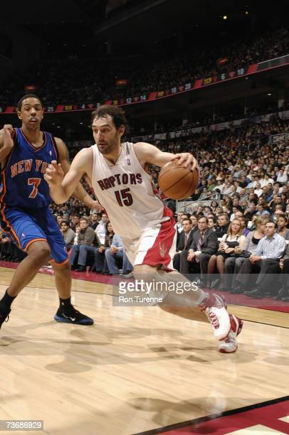 Jorge Garbajosa of the Toronto Raptors drives to the basket past Channing Frye of the New York Knicks during a game at Air Canada Centre on March 14...