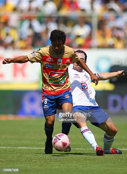 Jorge Gastelum of Morelia vies for the ball with Gerardo Torrado of Cruz Azul during their match as part of the Apertura 2010 at Morelos Stadium on...