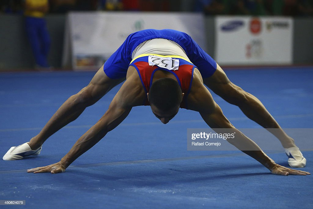 Jorge Giraldo of Colombia competes in Floor Event as part of the Men's Gymnastics All Around part of the XVII Bolivarian Games Trujillo 2013 at Villa Deportiva Regional del Callao on November 19, 2013 in Lima, Peru.
