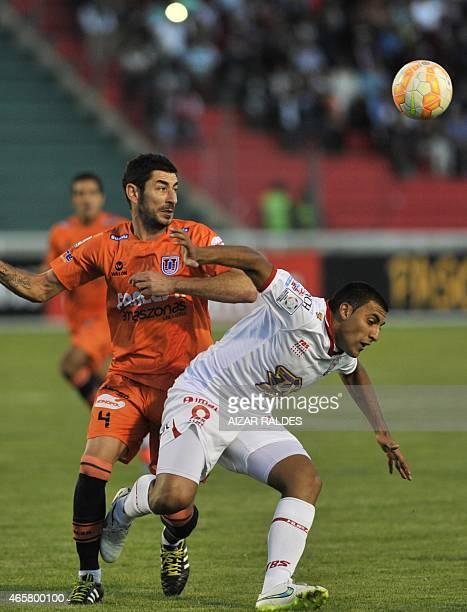Jorge Gonzales of Bolivia's Universitario de Sucre and Ramon Abila of Argentina's Huracan vie for the ball during their Libertadores Cup football...