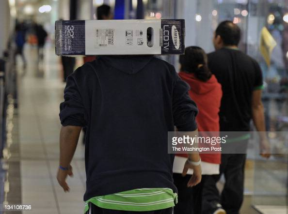 Jorge Gonzales of Hyattsville Maryland took to carrying a 32inch television on his head after his arms got tired from hauling the heavy box through...
