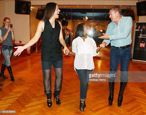 Jorge Gonzalez and Joachim Llambi walk in high heel shoes while Motsi Mabuse smiles during the IN Magazin Dance Club event at dancing school Reichelt...
