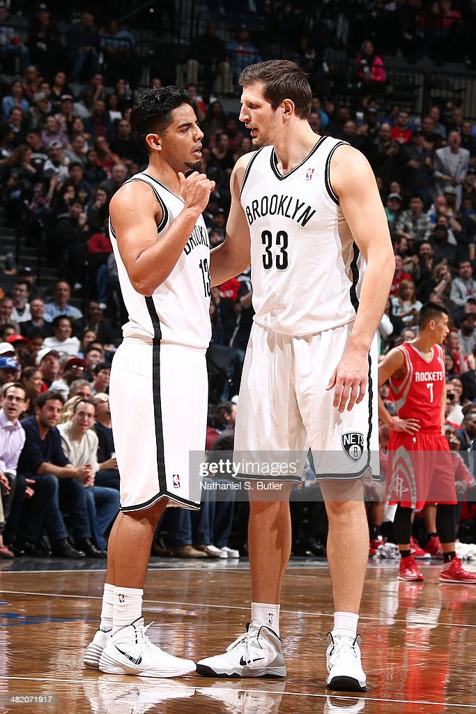 Jorge Gutierrez #13 and <a gi-track='captionPersonalityLinkClicked' href=/galleries/search?phrase=Mirza+Teletovic&family=editorial&specificpeople=2255667 ng-click='$event.stopPropagation()'>Mirza Teletovic</a> #33 of the Brooklyn Nets talk during the game against the Houston Rockets at the Barclays Center on April 01, 2014 in the Brooklyn borough of New York City.