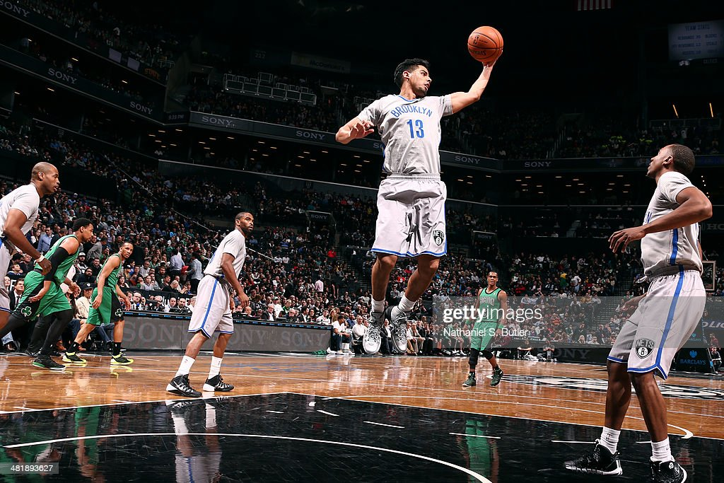 Jorge Gutierrez #13 of the Brooklyn Nets grabs a rebound against the Boston Celtics at the Barclays Center on March 21, 2014 in the Brooklyn borough of New York City.