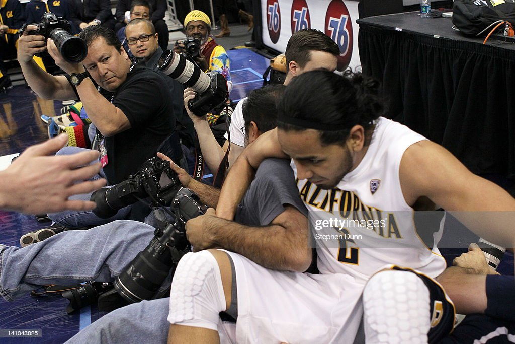 Jorge Gutierrez #2 of the California Golden Bears falls into a row of photographers as he attempts to save the ball in the second half against the Colorado Buffaloes in the semifinals of the 2012 Pacific Life Pac-12 men's basketball tournament at Staples Center on March 9, 2012 in Los Angeles, California.
