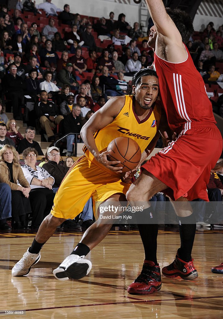 Jorge Gutierrez #7 of the Canton Charge drives to the hoop against Brian Cusworth #42 of the Maine Red Claws at the Canton Memorial Civic Center on November 23, 2012 in Canton, Ohio.