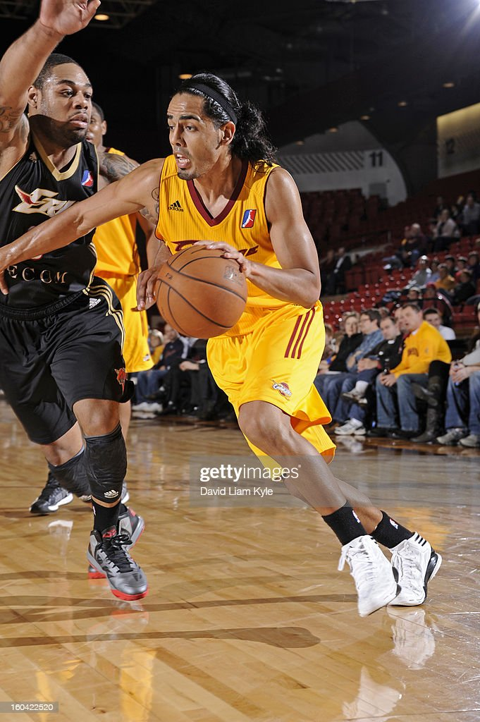 Jorge Gutierrez #7 of the Canton Charge drives to the hoop against <a gi-track='captionPersonalityLinkClicked' href=/galleries/search?phrase=Demetri+McCamey&family=editorial&specificpeople=4787987 ng-click='$event.stopPropagation()'>Demetri McCamey</a> #8 of the Erie BayHawks at the Canton Memorial Civic Center on January 30, 2013 in Canton, Ohio.