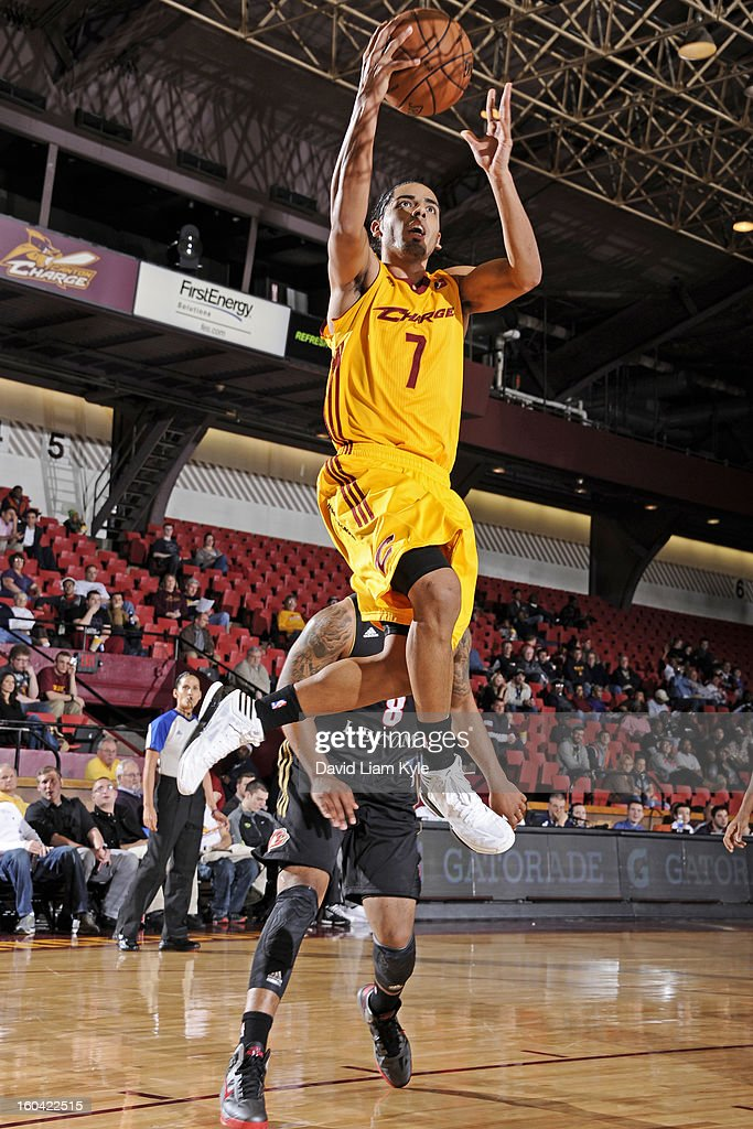 Jorge Gutierrez #7 of the Canton Charge goes up for the shot against <a gi-track='captionPersonalityLinkClicked' href=/galleries/search?phrase=Demetri+McCamey&family=editorial&specificpeople=4787987 ng-click='$event.stopPropagation()'>Demetri McCamey</a> #8 of the Erie BayHawks at the Canton Memorial Civic Center on January 30, 2013 in Canton, Ohio.