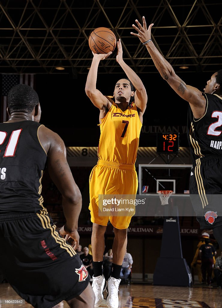 Jorge Gutierrez #7 of the Canton Charge shoots over <a gi-track='captionPersonalityLinkClicked' href=/galleries/search?phrase=Henry+Sims&family=editorial&specificpeople=5132323 ng-click='$event.stopPropagation()'>Henry Sims</a> #21 and Demonte Harper #22 of the Erie BayHawks at the Canton Memorial Civic Center on January 30, 2013 in Canton, Ohio.