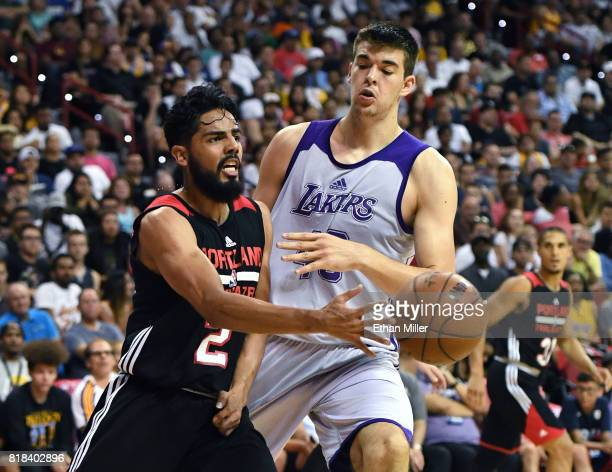 Jorge Gutierrez of the Portland Trail Blazers passes against Ivica Zubac of the Los Angeles Lakers during the championship game of the 2017 Summer...