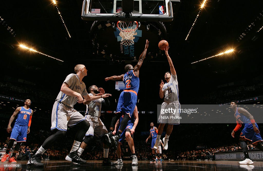 Jorge Gutierrez shoots against Raymond Felton #2 of the New York Knicks during a game at Barclays Center in Brooklyn.