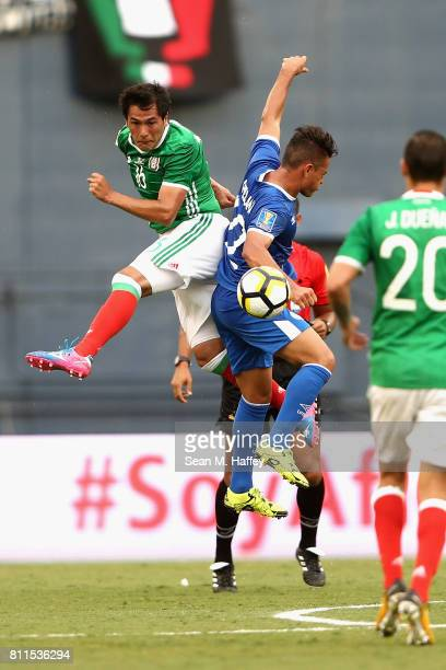 Jorge Hernandez of Mexico battles Narciso Orellana of El Salvador during the first half of a 2017 CONCACAF Gold Cup Group C match at Qualcomm Stadium...