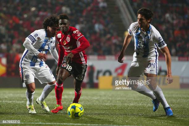 Jorge Hernandez of Pachuca and Aviles Hurtado of Tijuana fight for the ball during the 9th round match between Tijuana and Monterrey as part of the...