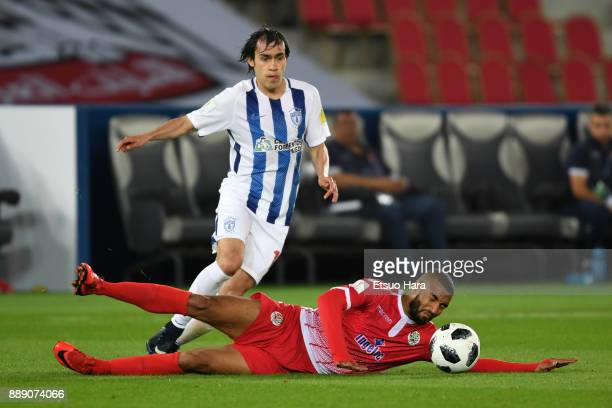 Jorge Hernandez of Pachuca and Mohamed Aoulad Youssef of Wydad Casablanca compete for the ball during the FIFA Club World Cup match between CF...