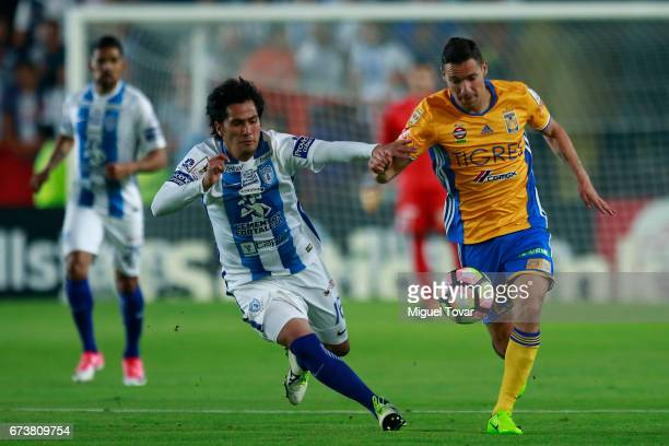 Jorge Hernandez of Pachuca fights for the ball with Jesus Dueñas of Tigres during the Final second leg match between Pachuca and Tigres UANL as part...