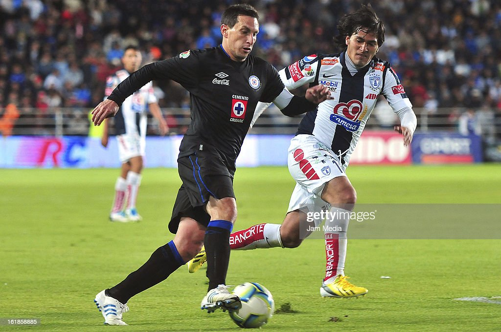 Jorge Hernandez (R) of Pachuca struggles for the ball with Christian Gimenez (L) of Cruz Azul during the Clausura 2013 Liga MX at Hidalgo Stadium on February 16, 2013 in Pachuca, Mexico.