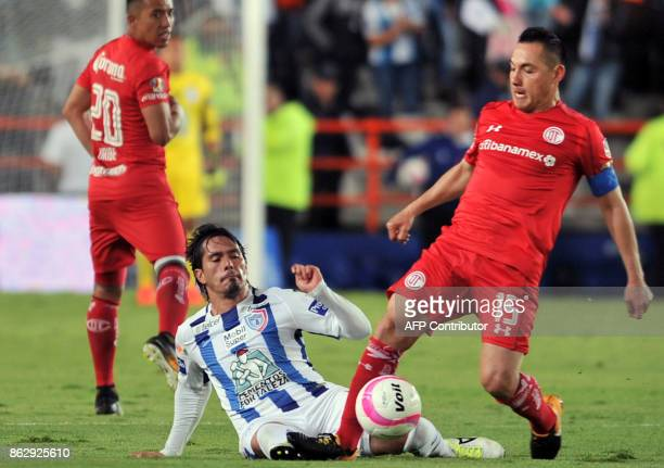Jorge Hernandez of Pachuca vies for the ball with Antonio Rios of Toluca during their Mexican Apertura tournament football match at the Hidalgo...