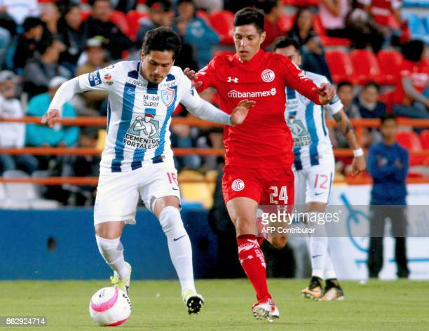 Jorge Hernandez of Pachuca vies for the ball with Pablo Barrientos of Toluca during their Mexican Apertura tournament football match at the Hidalgo...