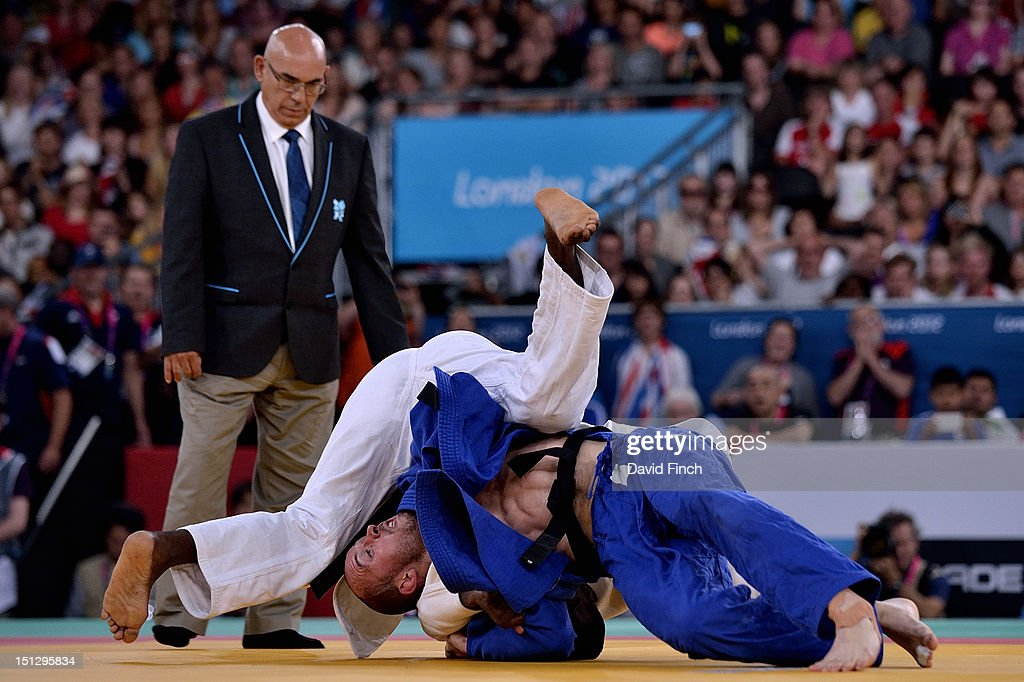 Jorge Herrezuelo Marcellis of Cuba (white) narrowly defeated Sam Ingram of Great Britain to win the u90kgs gold medal. Here, Sam Ingram catches the Cuban to nearly equalise the match on Day 3 of the London 2012 Paralympic Games at the ExCeL on April 30, 2012 in London, England.
