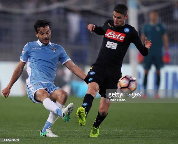 Jorge Jorginho of SSC Napoli competes for the ball with Marco Parolo of SS Lazio during the Serie A match between SS Lazio and SSC Napoli at Stadio...