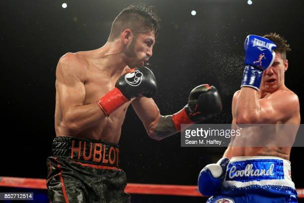 Jorge Linares of Venezuela exchanges punches with Luke Campbell of Great Britain during their WBA lightweight title bout at The Forum on September 23...