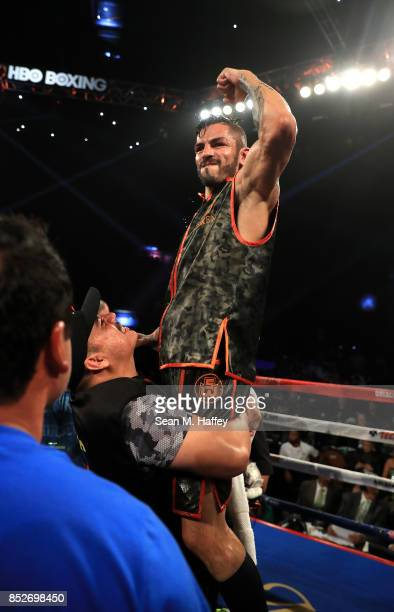 Jorge Linares of Venezuela is held up by coach Jorge Capetillo after defeating Luke Campbell of Great Britain in their WBA lightweight title bout at...