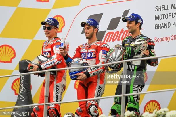 Jorge Lorenzo of Ducati Racing Team Andrea Dovizioso of Ducati Racing Team and Johann Zarco of Monster Yamaha Tech 3 celebrate on the podium after...
