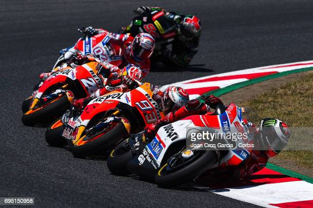 Jorge Lorenzo of Ducati Team Marc Marquez and Dani Pedrosa of Repsol Honda Team and Andrea Dovizioso of Ducati Team riding his bikes during the Moto...