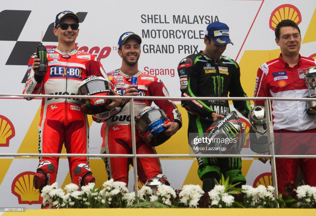 Jorge Lorenzo of Spain and Ducati Team, Andrea Dovizioso of Italy and Ducati Team and Johann Zarco of France and Monster Yamaha Tech 3 celebrate on the podium at the end of the MotoGP race during the MotoGP Of Malaysia - Race at Sepang Circuit on October 29, 2017 in Kuala Lumpur, Malaysia.