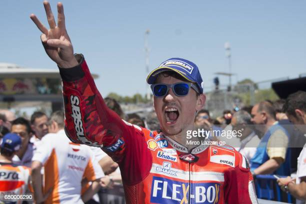 Jorge Lorenzo of Spain and Ducati Team celebrates the third place under the podium at the end of the MotoGP race during the MotoGp of Spain Race at...