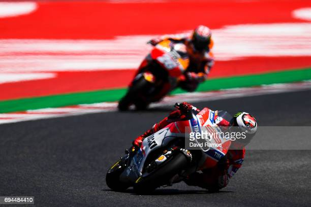 Jorge Lorenzo of Spain and Ducati Team rides ahead Dani Pedrosa of Spain and Repsol Honda Team during the qualifying at Circuit de Catalunya on June...