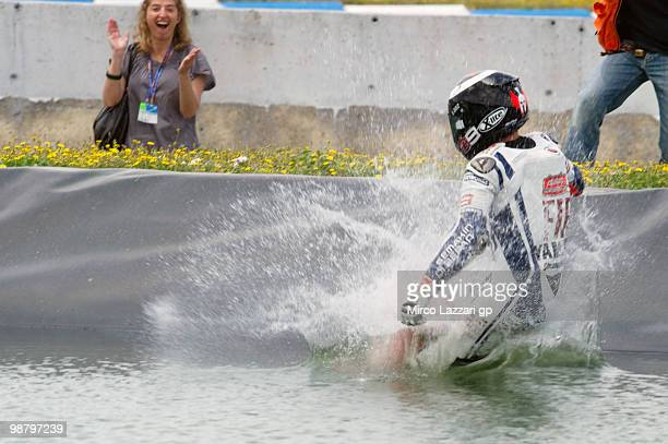 Jorge Lorenzo of Spain and Fiat Yamaha Team celebrates the victory and swimming on the lake at the end of the MotoGP race at Circuito de Jerez on May...