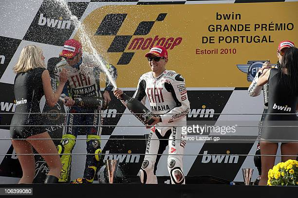 Jorge Lorenzo of Spain and Fiat Yamaha Team celebrates with Valentino Rossi of Italy and Fiat Yamaha Team and spray champagne on the podium at the...