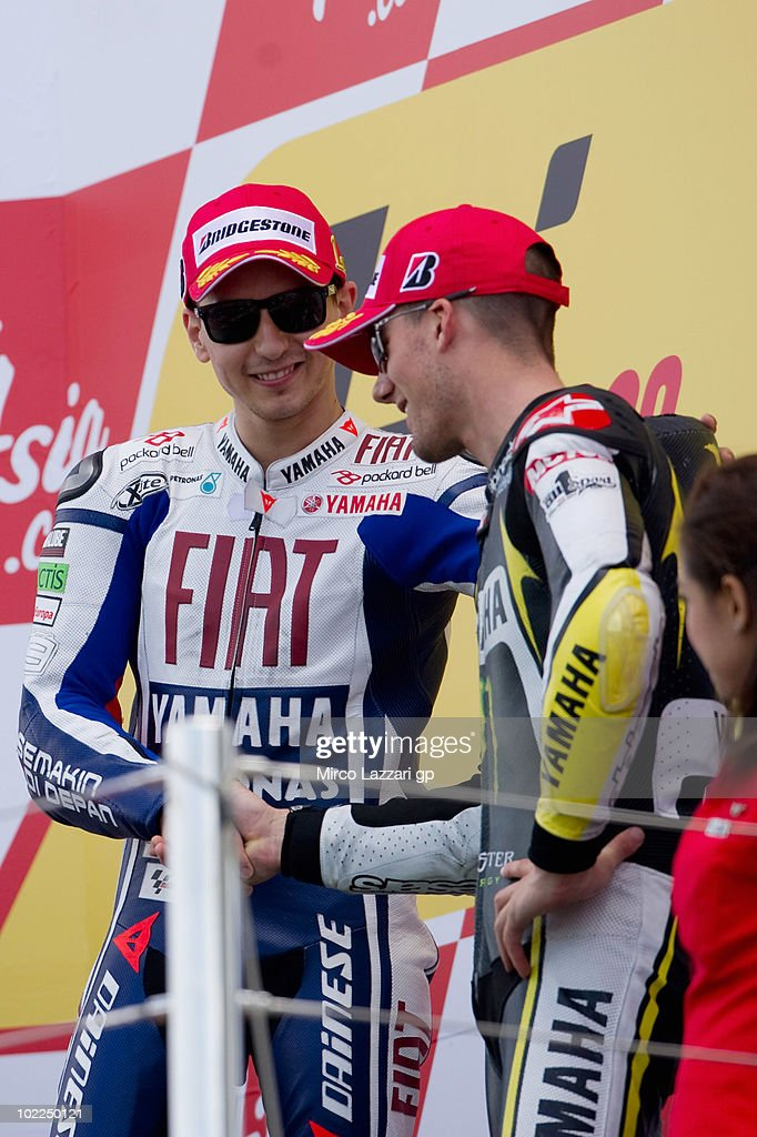 Jorge Lorenzo of Spain and Fiat Yamaha Team congratulates with Ben Spies of USA and Monster Yamaha Tech 3 on the podium at the end of MotoGP race of...