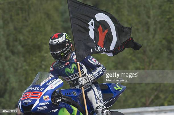 Jorge Lorenzo of Spain and Movistar Yamaha MotoGP celebrates the victory with flag at the end of the MotoGP race during the MotoGp of Czech Republic...