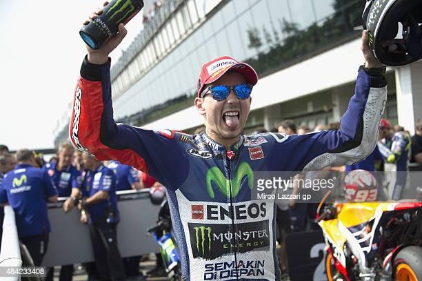 Jorge Lorenzo of Spain and Movistar Yamaha MotoGP celebrates the victory under the podium at the end of the MotoGP race during the MotoGp of Czech...