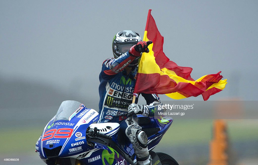 Jorge Lorenzo of Spain and Movistar Yamaha MotoGP celebrates with the flag of Spain after winning the MotoGP of Spain at Motorland Aragon Circuit on September 28, 2014 in Alcaniz, Spain.