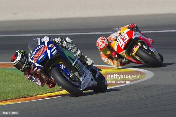 Jorge Lorenzo of Spain and Movistar Yamaha MotoGP leads Marc Marquez of Spain and Repsol Honda Team during the MotoGP race during the MotoGP of...