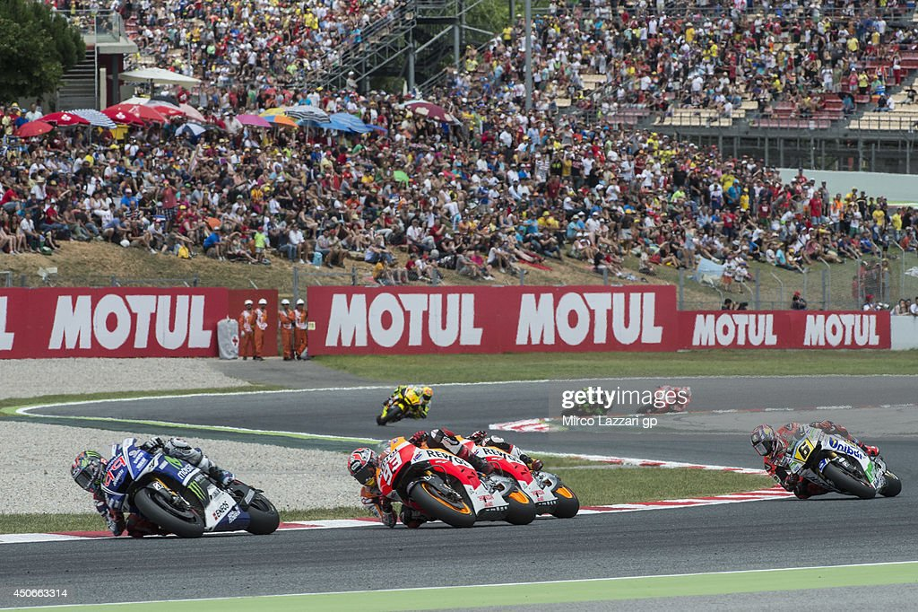 <a gi-track='captionPersonalityLinkClicked' href=/galleries/search?phrase=Jorge+Lorenzo&family=editorial&specificpeople=543869 ng-click='$event.stopPropagation()'>Jorge Lorenzo</a> of Spain and Movistar Yamaha MotoGP leads the field during the Moto GP race during the MotoGp of Catalunya - Race at Circuit de Catalunya on June 15, 2014 in Montmelo, Spain.