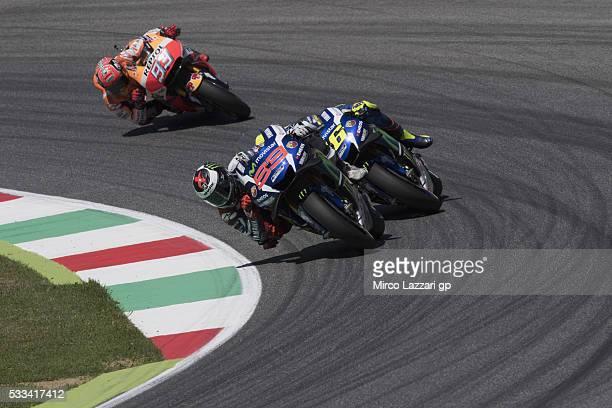Jorge Lorenzo of Spain and Movistar Yamaha MotoGP leads Valentino Rossi of Italy and Movistar Yamaha MotoGP and Marc Marquez of Spain and Repsol...