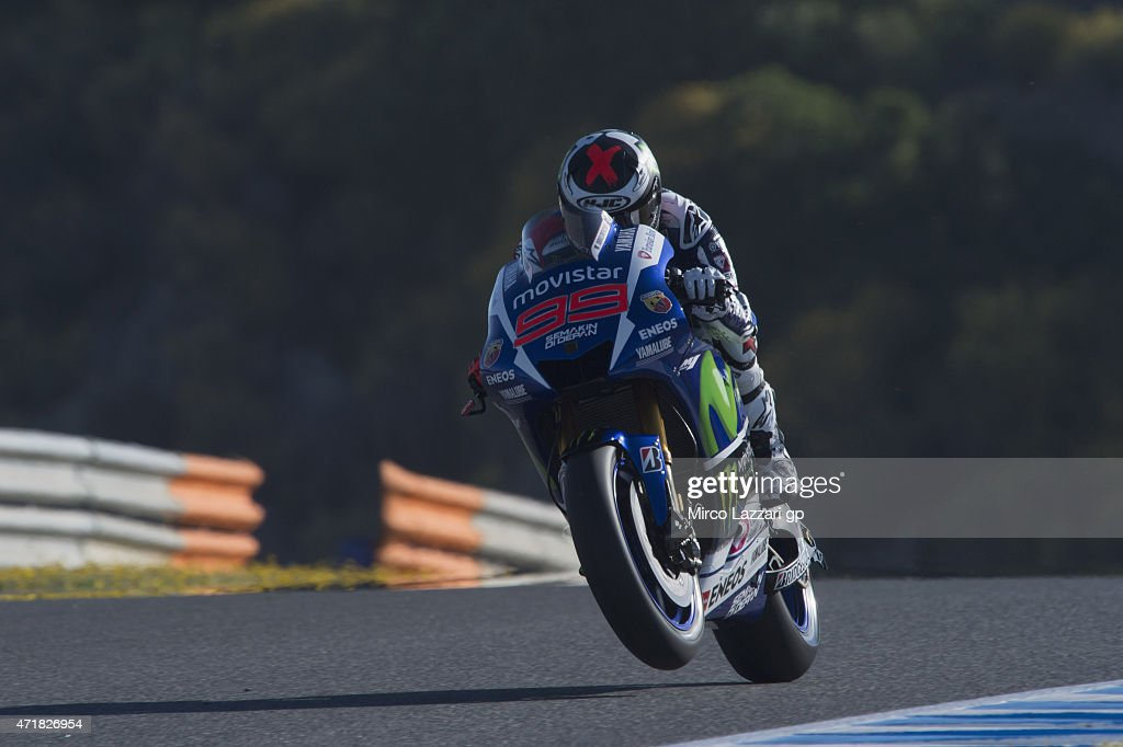 <a gi-track='captionPersonalityLinkClicked' href=/galleries/search?phrase=Jorge+Lorenzo&family=editorial&specificpeople=543869 ng-click='$event.stopPropagation()'>Jorge Lorenzo</a> of Spain and Movistar Yamaha MotoGP lifts the front wheel during the MotoGp of Spain - Free Practice at Circuito de Jerez on May 1, 2015 in Jerez de la Frontera, Spain.