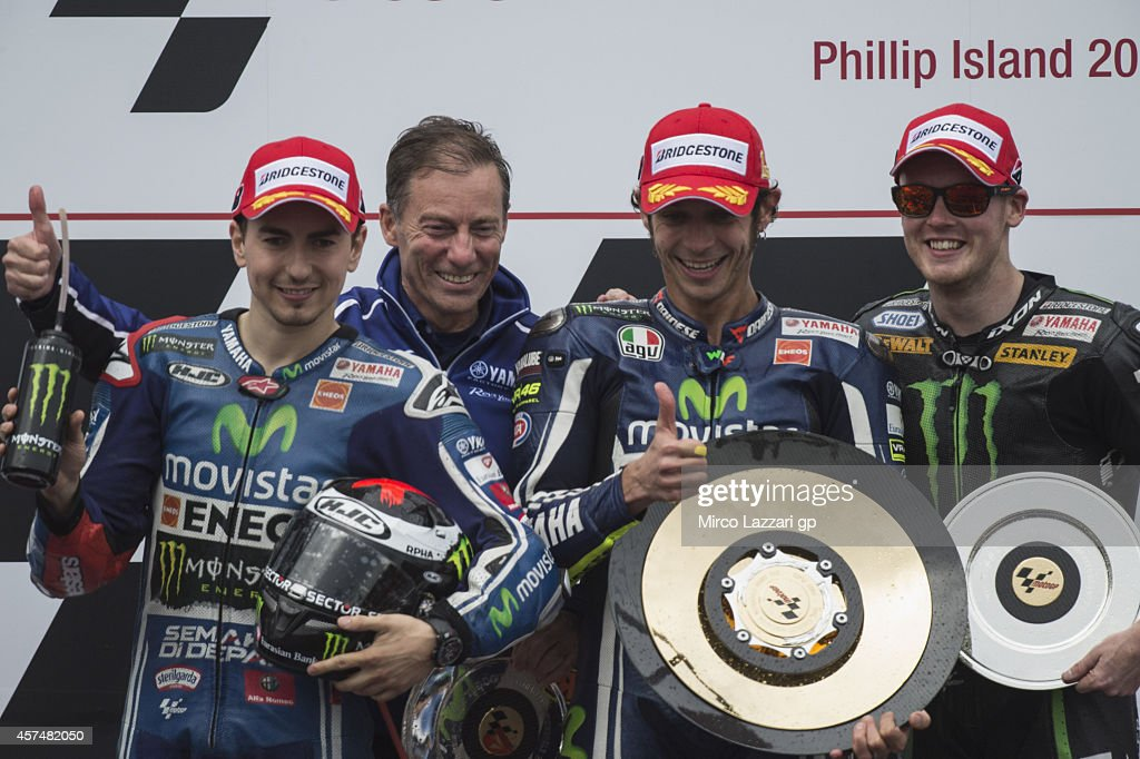 <a gi-track='captionPersonalityLinkClicked' href=/galleries/search?phrase=Jorge+Lorenzo&family=editorial&specificpeople=543869 ng-click='$event.stopPropagation()'>Jorge Lorenzo</a> of Spain and Movistar Yamaha MotoGP, <a gi-track='captionPersonalityLinkClicked' href=/galleries/search?phrase=Lin+Jarvis&family=editorial&specificpeople=6489029 ng-click='$event.stopPropagation()'>Lin Jarvis</a> of Britain and Yamaha Factory Team, <a gi-track='captionPersonalityLinkClicked' href=/galleries/search?phrase=Valentino+Rossi&family=editorial&specificpeople=157603 ng-click='$event.stopPropagation()'>Valentino Rossi</a> of Italy and Movistar Yamaha MotoGP and Bradley Smith of Great Britain and Monster Yamaha Tech 3 celebrate on the podium at the end of the MotoGP race during the 2014 MotoGP of Australia at Phillip Island Grand Prix Circuit on October 19, 2014 in Phillip Island, Australia.