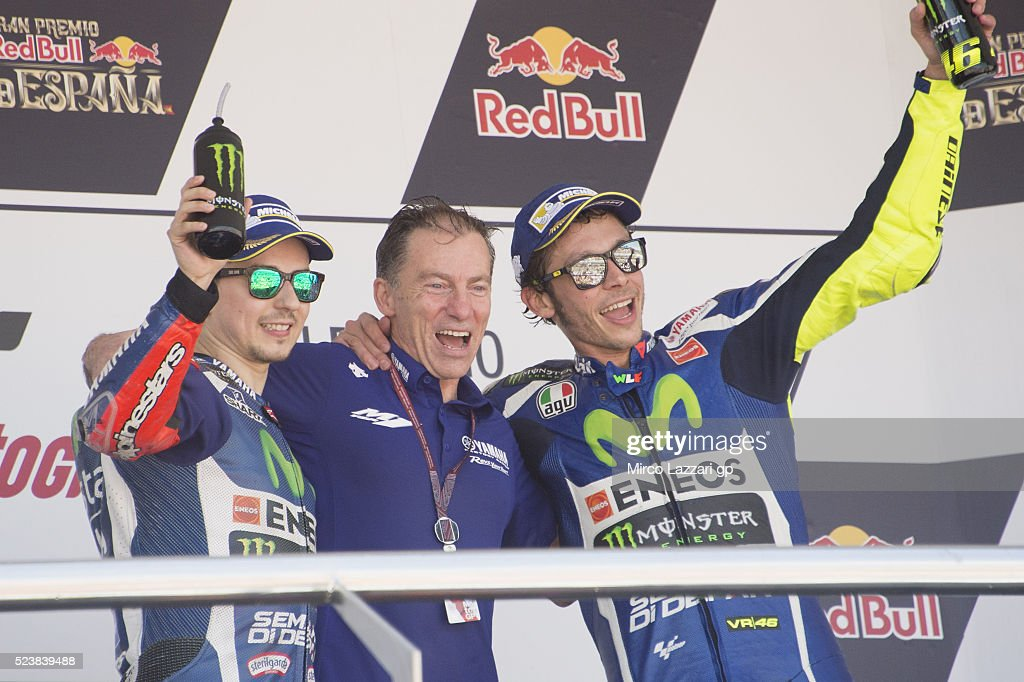 <a gi-track='captionPersonalityLinkClicked' href=/galleries/search?phrase=Jorge+Lorenzo&family=editorial&specificpeople=543869 ng-click='$event.stopPropagation()'>Jorge Lorenzo</a> of Spain and Movistar Yamaha MotoGP, <a gi-track='captionPersonalityLinkClicked' href=/galleries/search?phrase=Lin+Jarvis&family=editorial&specificpeople=6489029 ng-click='$event.stopPropagation()'>Lin Jarvis</a> of Britain and Yamaha Factory Team and <a gi-track='captionPersonalityLinkClicked' href=/galleries/search?phrase=Valentino+Rossi&family=editorial&specificpeople=157603 ng-click='$event.stopPropagation()'>Valentino Rossi</a> of Italy and Movistar Yamaha MotoGP on the podium at the end of the MotoGP race during the MotoGp of Spain - Race at Circuito de Jerez on April 24, 2016 in Jerez de la Frontera, Spain.